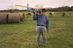 Farmer shows his plane.